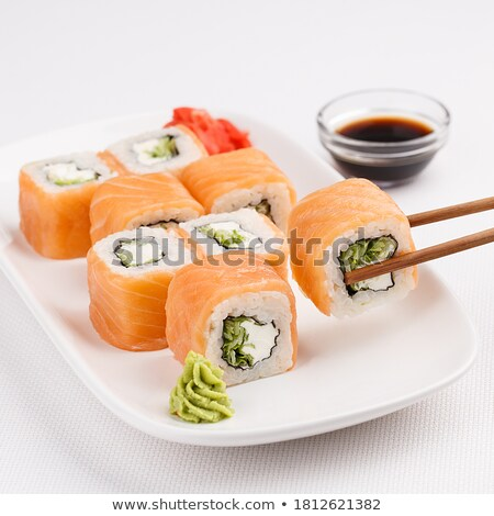 Portion of roll with fresh salmon over white background Stock photo © amok