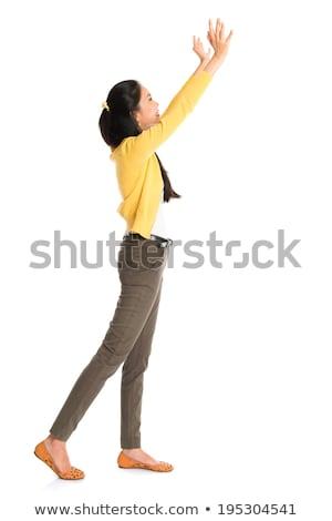 Asian donna spingendo qualcosa vista laterale profilo Foto d'archivio © szefei