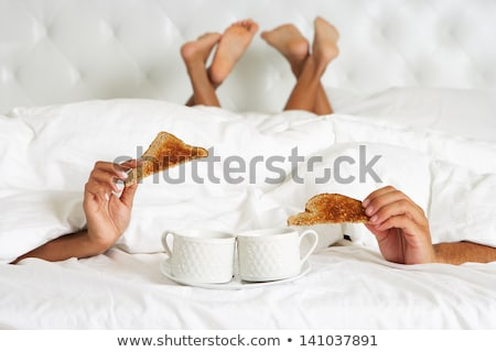 Couple Relaxing In Bed Hiding Under Duvet Stock photo © monkey_business