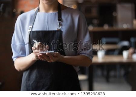 serveerster · om · papier · hand · vrouwen · pen - stockfoto © highwaystarz