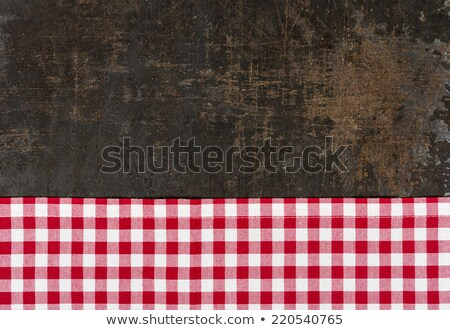 Antique baking tray with a red checkered tablecloth Stock photo © Zerbor