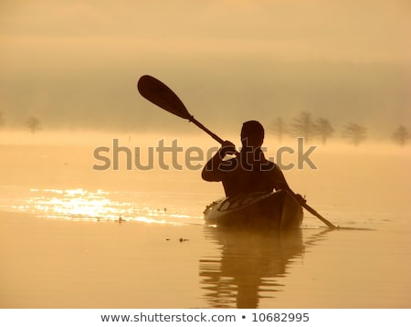 golden sunset kayak silhouette stock photo © jameswheeler
