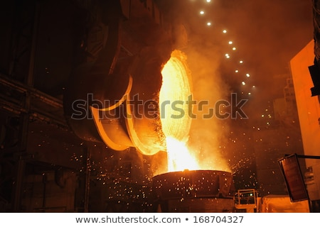 Molten steel pouring stock photo © mady70
