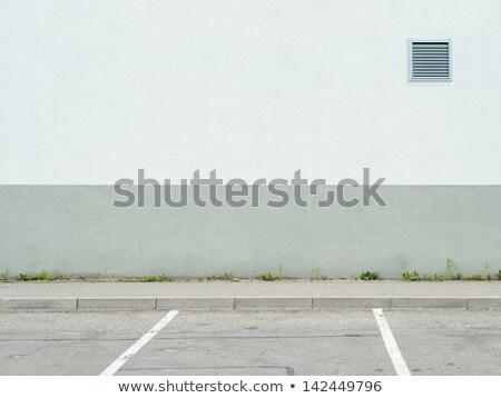 Stock photo: Gray Door in a Cement Wall