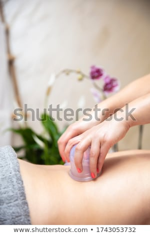 woman receiving cupping massage at beauty spa stock photo © andreypopov