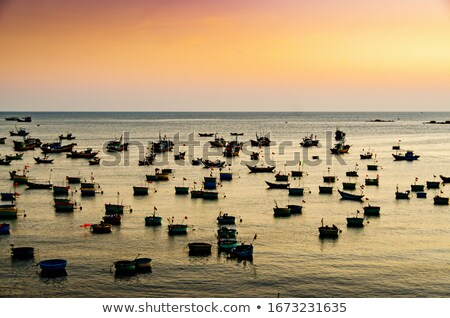 small fishing boats in south china sea at dusk mui ne vietnam stock photo © fisfra