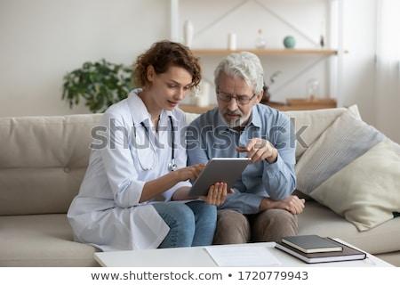 old man using a digital tablet Stock photo © Giulio_Fornasar