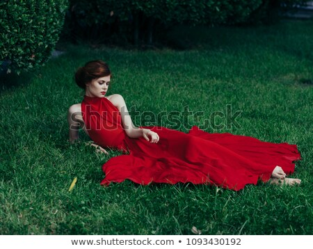 Сток-фото: Young Beautiful Barefooted Woman In Red Dress Lies On White Leat