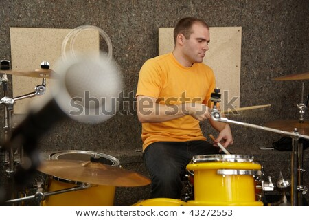 Drummer near drumkit. microphone in out of focus Stock photo © Paha_L