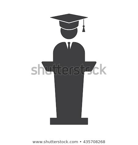 Graduate standing near tribune line icon. Stock photo © RAStudio