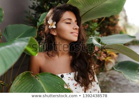 pretty young woman in a tropical garden stock photo © dash