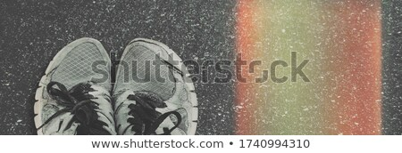 Worn sneakers on grunge pavement Stock photo © stevanovicigor