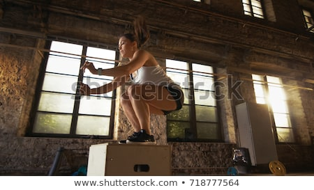 Girl does exercise with fitness rope in gym Stock photo © bezikus