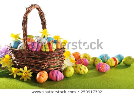 colorful easter eggs and narcissus in easter nest  Stock photo © Yatsenko