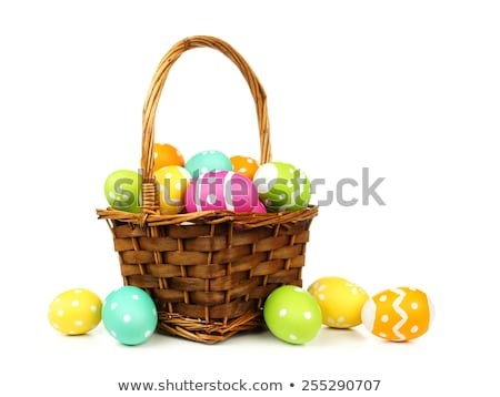 painted easter eggs basket on wooden background stock photo © kidza