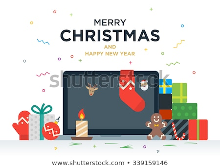 laptop with gifts candles red ball and christmas socks stock photo © tkacchuk