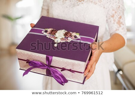 Woman in a white bridal dress holding a gift box. Stock photo © RAStudio