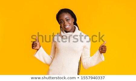 Glad young african american woman showing thumbs up Stock photo © NikoDzhi