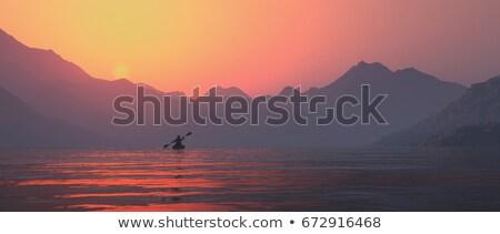 Landscape orientation, single kayaker on a lake Stock photo © orla