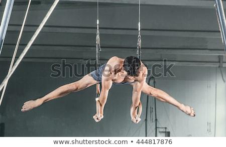 Tornász mozdulatlan gyűrűk sportoló előad nehéz Stock fotó © master1305