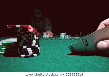 a combination of playing cards for casino two aces on bokeh background stock photo © m_pavlov