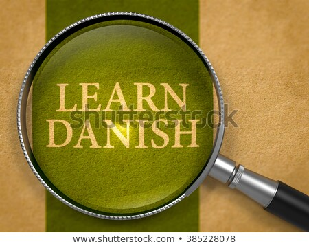 Learn Danish through Loupe on Old Paper. Stock photo © tashatuvango