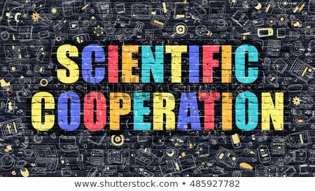 Scientific Cooperation Concept. Multicolor on Dark Brickwall. Stock photo © tashatuvango