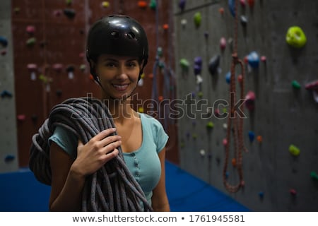female athlete in sports helmet carrying rope while standing at exercise class stock photo © wavebreak_media