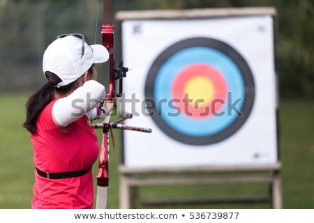 Young caucasian archer training with a bow. Stock photo © RAStudio
