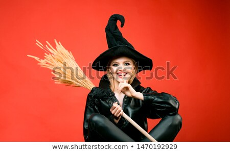 smiling woman in halloween costume like witch holding broom stock photo © deandrobot