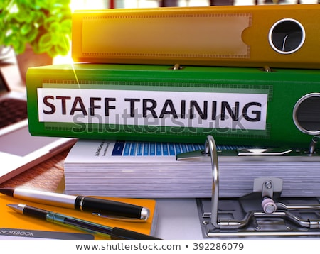 Staff on File Folder. Toned Image. Stock photo © tashatuvango