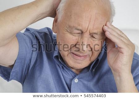man with severe headache stock photo © rogistok