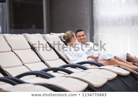 man in pool admiring young woman Stock photo © IS2