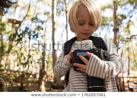 Little girl with a backpack holding dslr camera Stock photo © wavebreak_media