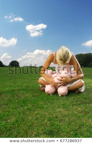 woman clutching piggy banks Stock photo © IS2