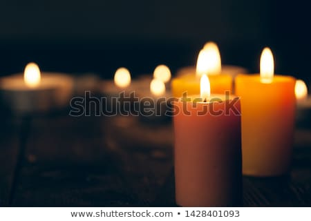 candle burning in darkness over black background Stock photo © dolgachov