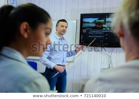 Driving instructor explains theory of driving Stock photo © Kzenon
