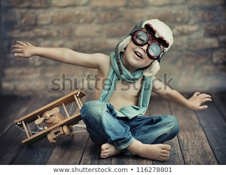 Caucasian cheerful boy playing with a toy airplane Stock photo © RAStudio