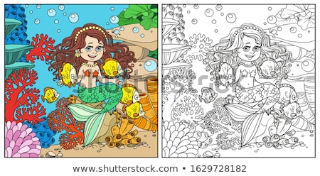 Crown fish playing in coral reef Stock photo © bluering