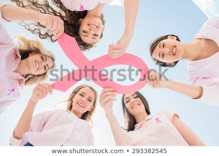 smiling woman for breast cancer awareness on white background with hands up stock photo © wavebreak_media