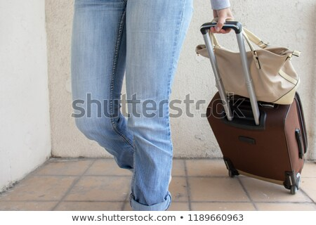 The young family with suitcase in relocation concept Stock photo © Elnur