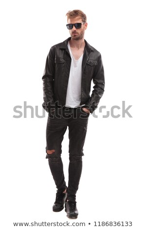 relaxed man with sunglasses walking and looking down to side Stock photo © feedough