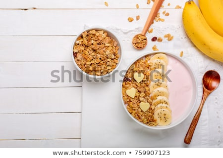 white bowl with homemade granola sliced strawberries yogurt blueberry spoon   natural breakfast stock photo © artjazz