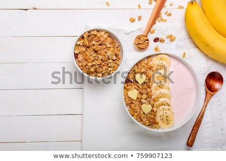 Branco tigela caseiro granola morangos Foto stock © artjazz