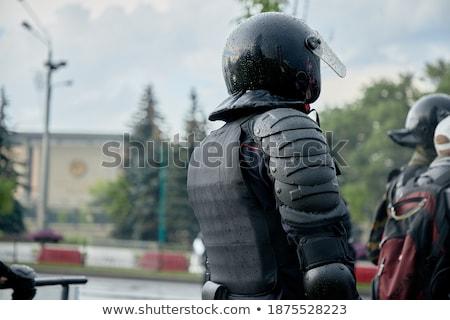 Armado soldado em pé chuva chuvoso tempo Foto stock © ra2studio
