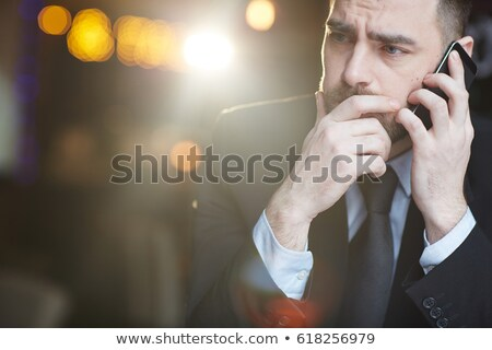 Confused man speaking on phone Stock photo © ichiosea