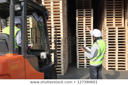 businessman and loader in forklift at warehouse Stock photo © dolgachov