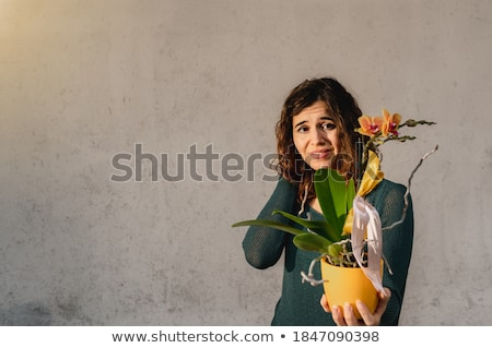 close up of gardener with pots showing thumbs up Stock photo © dolgachov