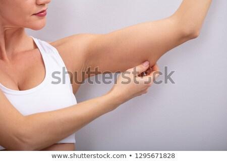 Mujer grasa armas primer plano encajar Foto stock © AndreyPopov
