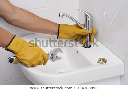 worker fixing water tap stock photo © andreypopov